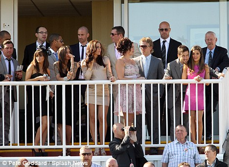 Grand day out: Joe and Carly, far right, were guests at Aintree with Liverpool Football Club and the rest of the WAGs