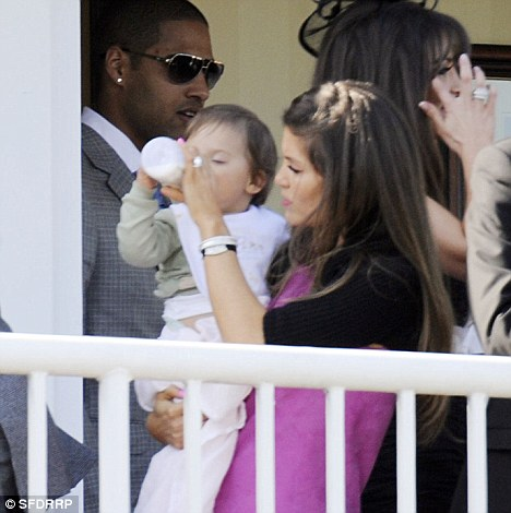 Cheers! Ruby toasts daddy's success on the gee-gees with a celebratory swig of milk