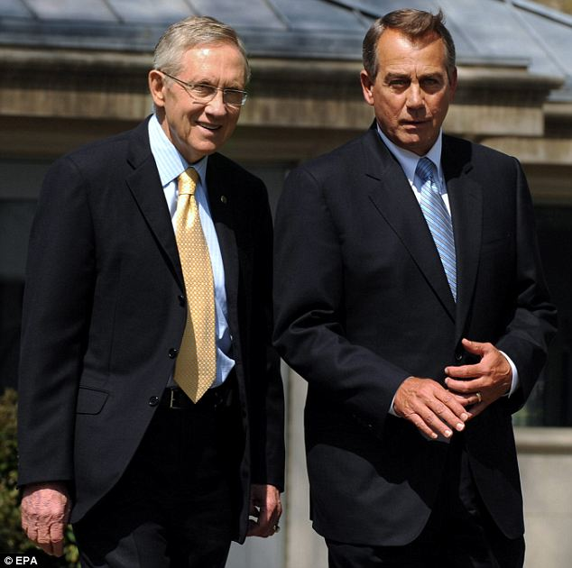 Compromise: US Speaker of the House John Boehner (R) and U.S. Senate Majority Leader Harry Reid (L) continued discussions today