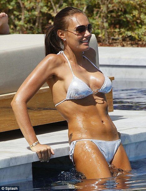 Cool down: Tamara Ecclestone enjoys a cooling dip in the pool at The One And Only Hotel at The Palm in Dubai