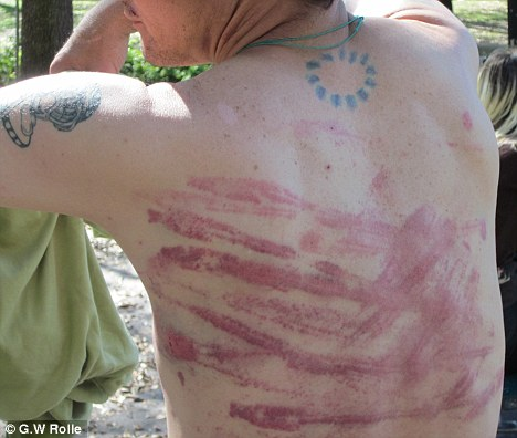 Whipped: George Grayson, 37, was left with painful lacerations to his back after allegedly being paid $25 to be flogged in a fetish video