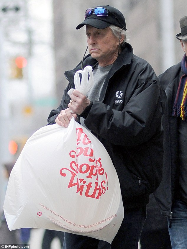 Difficult time: Douglas picked up supplies in New York City yesterday