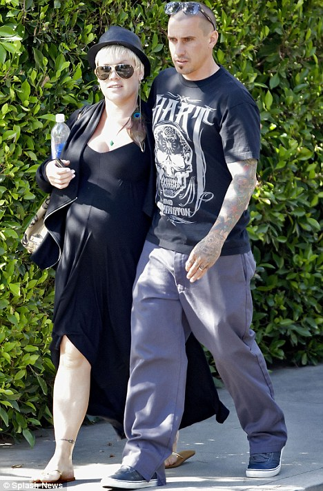 Quality time: Carey Hart played the protective father-to-be by walking with his arm around his pregnant wife Pink
