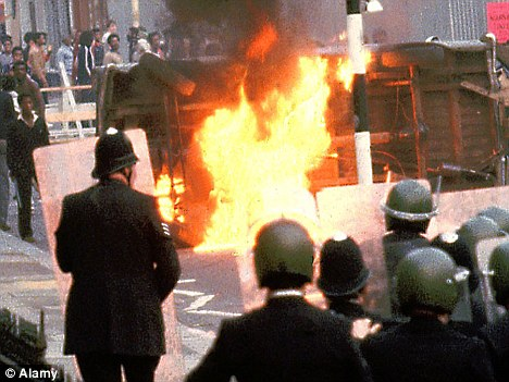 Front line: Police and rioters clash on the streets of Brixton 30 years ago