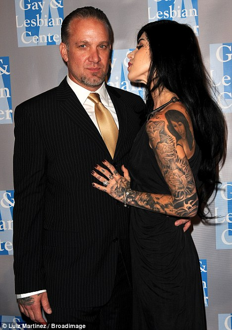 Inked: The pair selected an uncharacteristic classic look for the event, but their tattoos were still evident