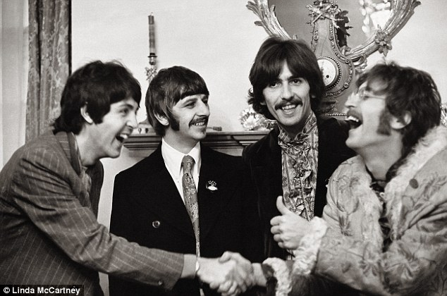 Husband's band: Linda photographed Sir Paul with the Beatles in 1968 in black and white