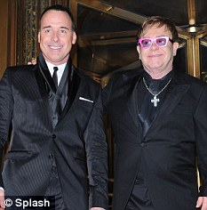 Meet the parents: Elton and David Furnish at a party in New York earlier this month