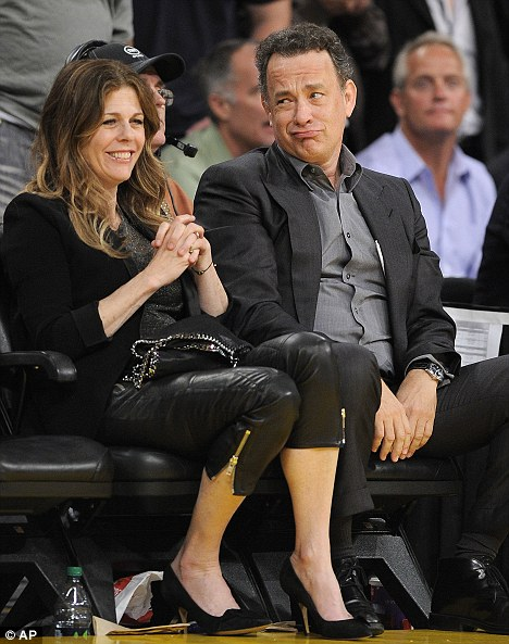 What are you Lake?: Tom Hanks pulls a funny face at his wife Rita Wilson during the game