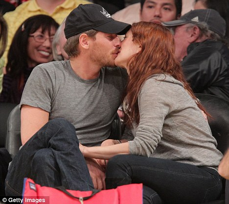 Lip service: Drew Barrymore and Will Kopelman share a kiss during the match