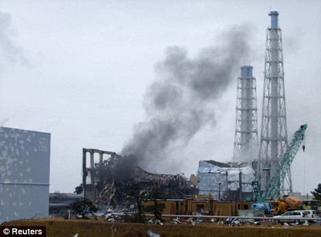 Smoke seen coming from the Fukushima Daiichi nuclear power plant in Tomioka, northeastern Japan, in the aftermath of the devastating quake
