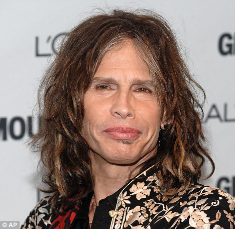 Dude looks like a lady: The study found that women are attracted to men with feminine faces, such as Steven Tyler who is famed for his pouty and full lips