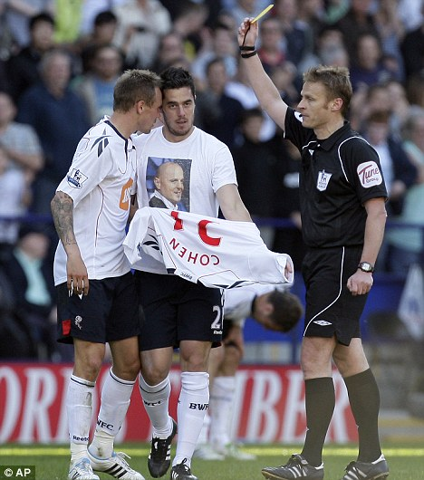 Madness? Referee Mike Jones (right) shows Bolton's Tamir Cohen (centre) a yellow card