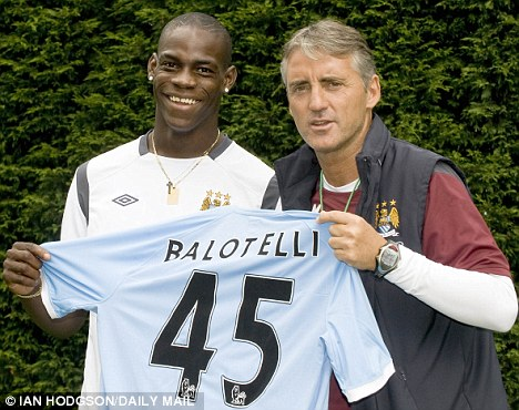 Big signing: Balotelli, seen here with manager Roberto Mancini, was snapped up by Manchester City for a cool £22.5million