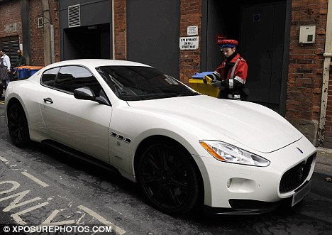 Another day, another ticket: Balotelli's Maserati gets a ticket outside a restaurant in Manchester city centre