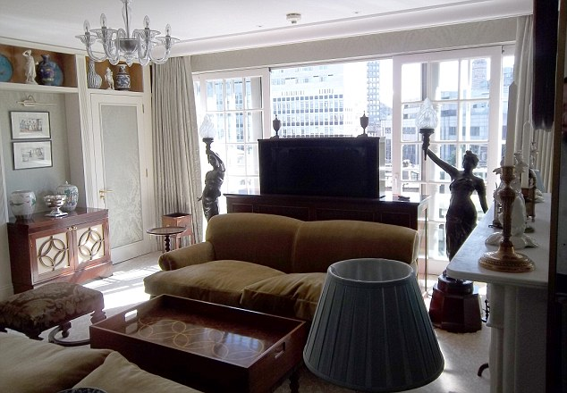 The Royal Apartment at the Goring Hotel: Bronze statues of women holding torches in the main sitting room