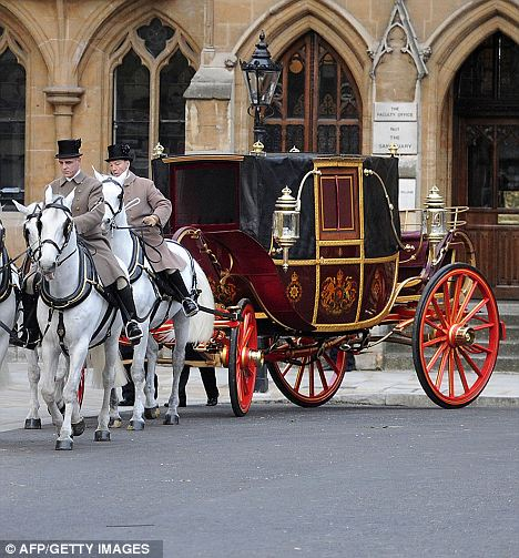 A horse drawn carriage is driven past London's Westminster Abbey as part of today's dress rehearsal for Friday's big event