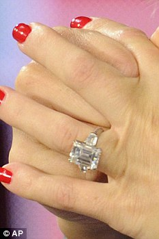 Bling: Kate showed off her diamond after revealing she has been engaged for a week
