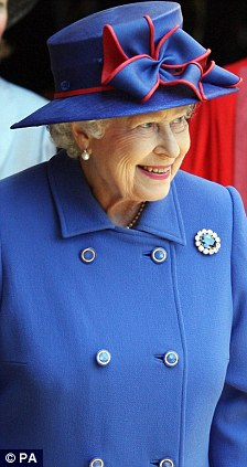 Looking forward to the big day: The Queen visiting Cambridge yesterday