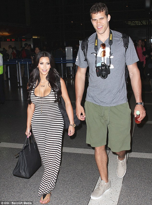 Not a big problem: The height difference between Kim Kardashian and boyfriend Kris Humphries is huge