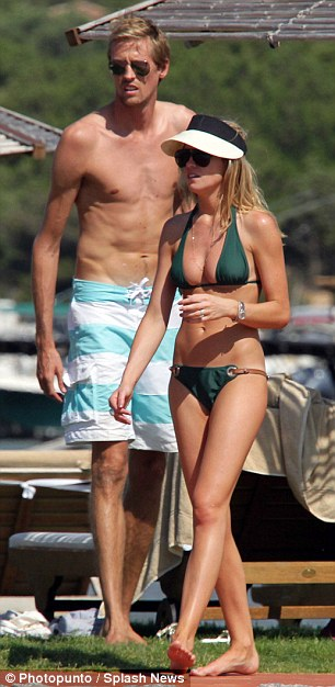 """... as does 6'7"""" Peter Crouch over fiancee Abbey Clancey"""