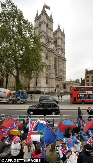 Royal fans gather outside Westminster Abbey ahead of the big day