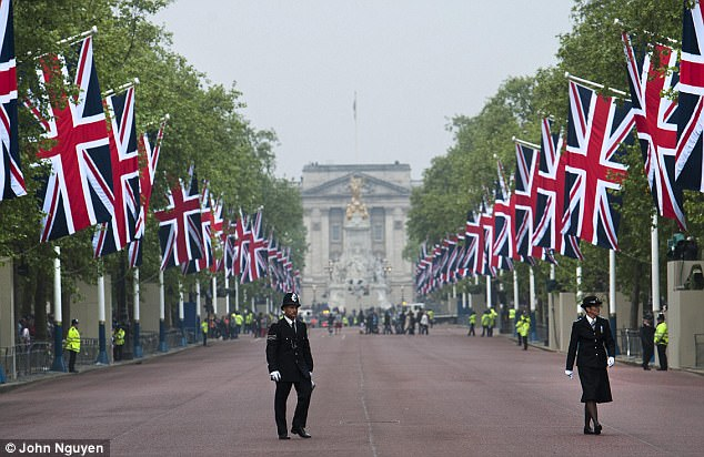 Last check: Police officers in dress uniform do a final patrol on The Mall in London in preparation for the Royal procession on the wedding day of Prince William and Kate Middleton