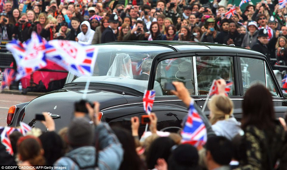 A new beginning: Crowds cheer as Kate Middleton travels in a Rolls Royce Phantom VI, accompanied by her father Michael Middleton to Westminster Abbey