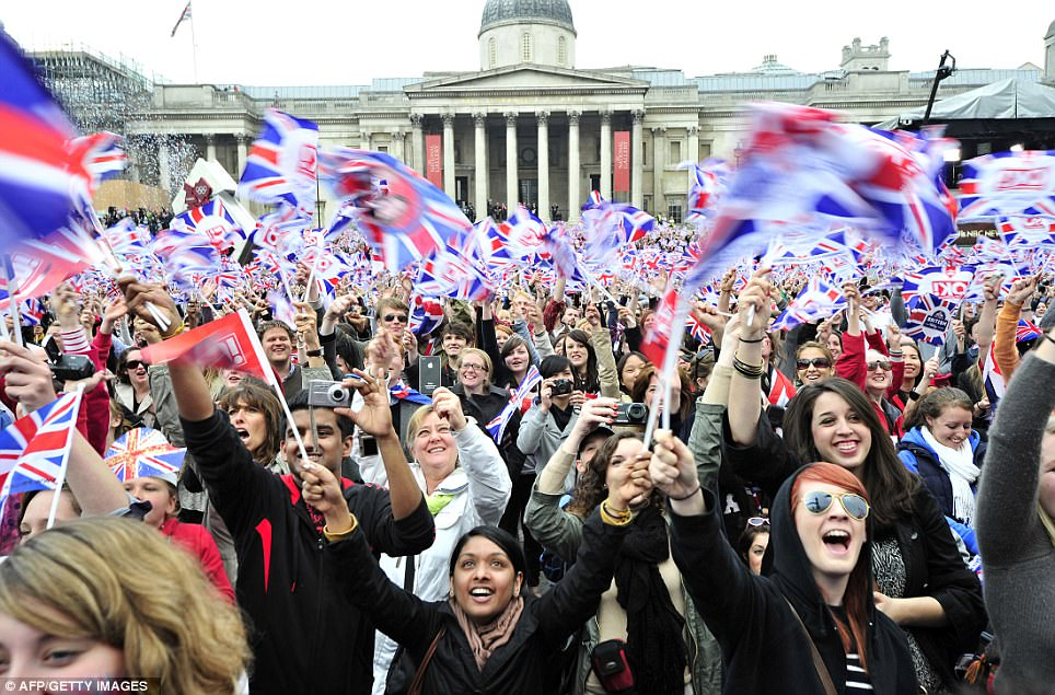 Let's party! Trafalgar Square wave and cheer in unison for the Royal couple