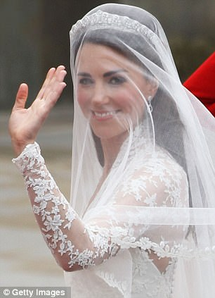 Catherine Middleton waves as she arrives for the Royal Wedding