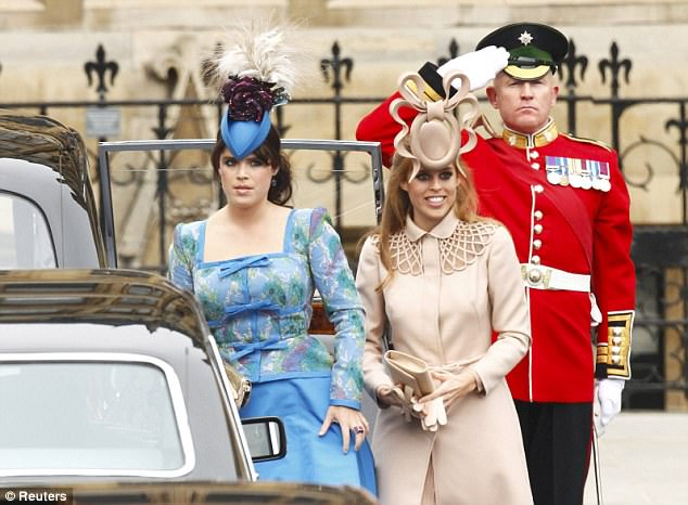 Hats off to them: Princesses Eugenie and Beatrice both wore eye-catching headgear for the ceremony