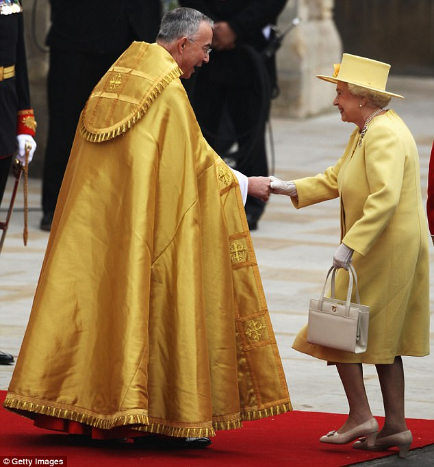 Royal greeting: The Queen met with Reverend John Hall, the Dean of Westminster, as she arrived at the Abbey