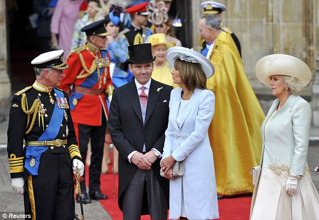 In-laws together: Charles and Camilla joined Carole and James Middleton on the red carpet after the service as they waited for their carriages