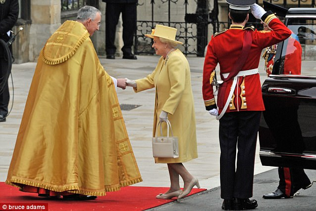 Splash of colour: The Queen wore an Angela Kelly-designed yellow primrose coat