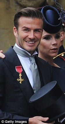 Switcheroo: David Beckham arrived at the wedding with his OBE medal on the right side of his suit lapel, but later changed it to the left