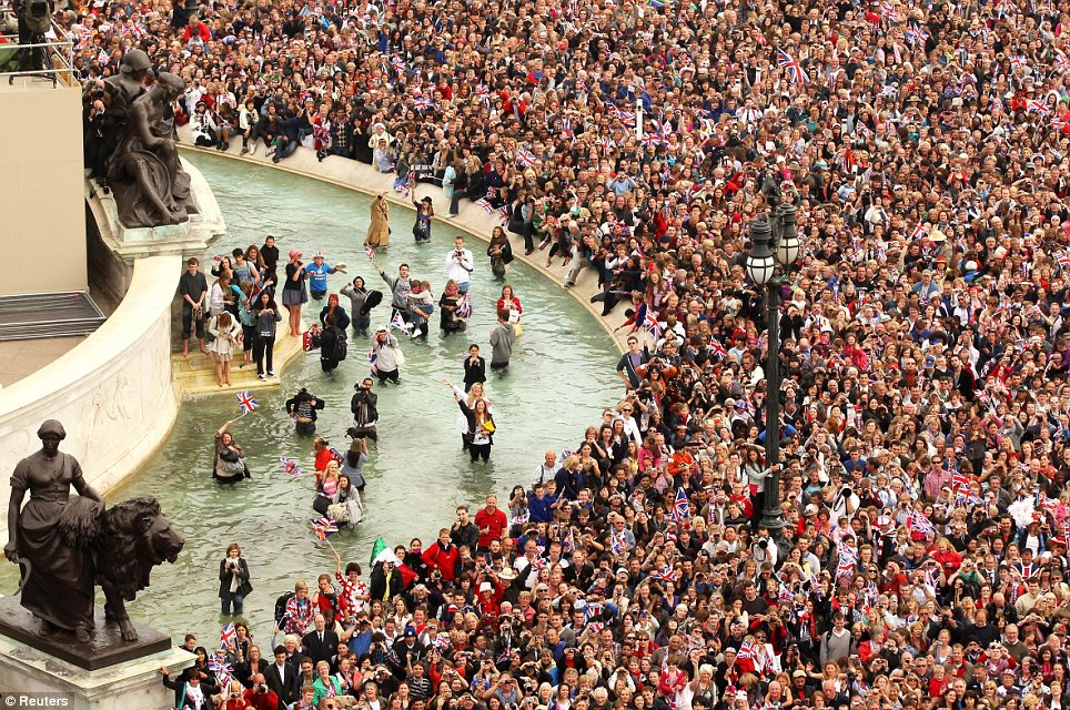 Making a splash: Excited fans jumped into the fountains in front of Buckingham Palace