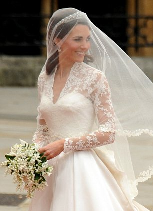 The veil was made of layers of soft, ivory silk tulle with a trim of hand-embroidered flowers, which was embroidered by the Royal School of Needlework