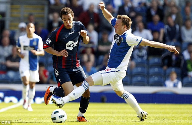 Going nowhere: Bolton's Rodrigo (left) is fouled by Blackburn's Phil Jones