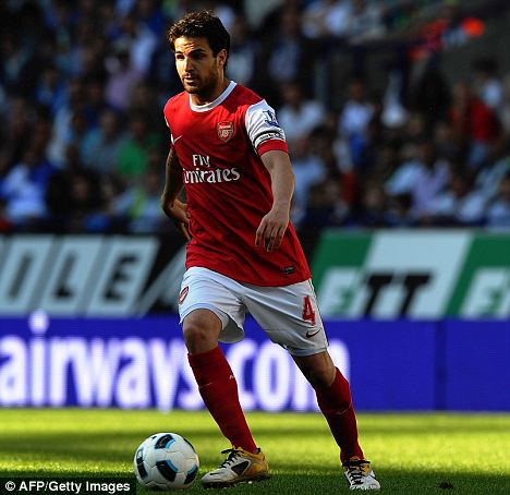 Feeling the strain: Fabregas on the pitch at last weekend's game against the Bolton Wanderers