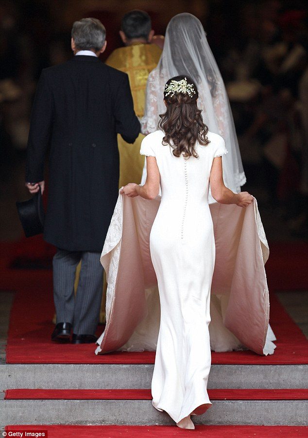 Rear of the year: Pippa follows her father and Kate into Westminster Abbey. She has become an overnight sensation following the televised coverage