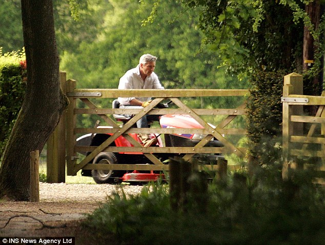 Back to reality: Michael Middleton mowing the lawn days after he walked his daughter down the aisle