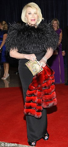 Red carpet glamour: Ugly Betty star America Ferrera and Joan Rivers put in a good show as they make their way into the event