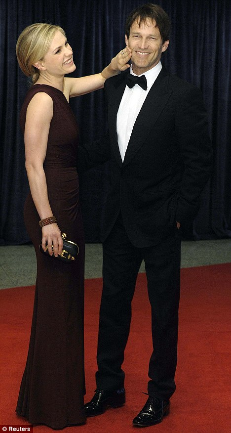 Hunger pangs: Anna Paquin wipes lipstick off husband Stephen Moyer's face, or was it blood?