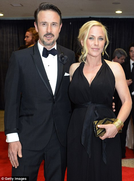 Family affair: David and Patricia Arquette pose on the red carpet at the White House event