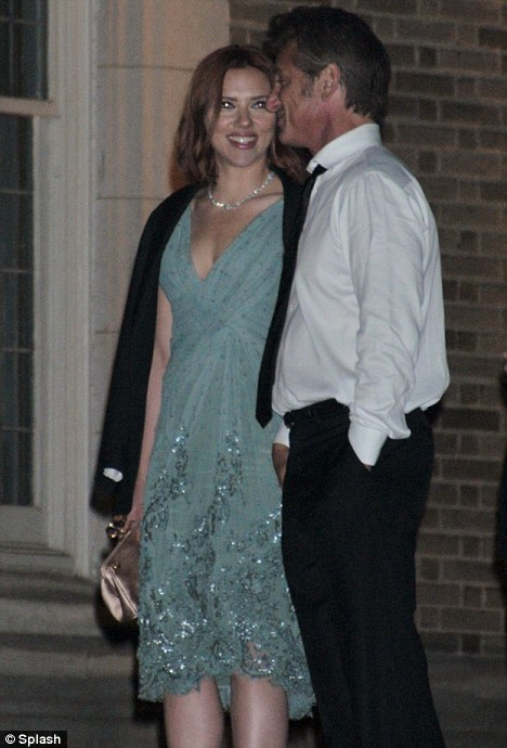 Look of love?: Scarlett smiles at her rumoured beau as they make their way out of the White House grounds