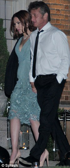 Cover up: The actress had Penn's jacket wrapped around her as they left the annual Washington Correspondents dinner