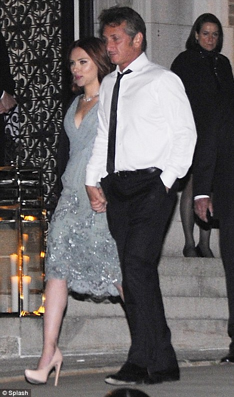 Caught red-handed: Scarlett Johansson and Sean Penn leave the White House in the early hours holding hands