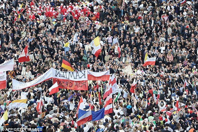 Devout: Hundreds of thousands of pilgrims have gathered in St Peter's Square, the Vatican, for the beatification of Pope John Paul II