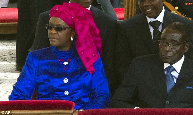 Controversial: Zimbabwean President Robert Mugabe flouted a European travel ban to attend the mass with his wife Grace