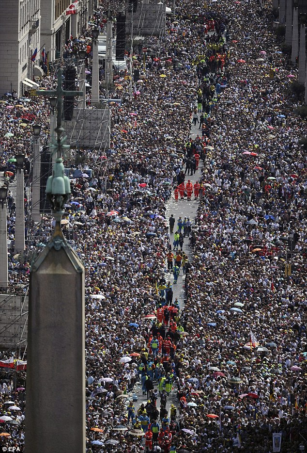 Teeming faithful: A million people are believed to have crammed into the Vatican to watch the beatification of Pope John Paul II