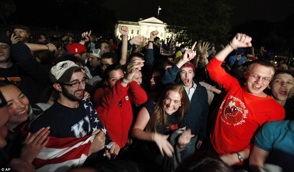 Celebration: Crowds cheered outside the White House this evening as President Obama confirmed the the nation that Al Qaeda leader Osama Bin Laden had been killed by U.S. Forces earlier in the day